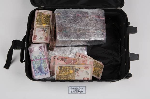Some of the cash recovered by authorities during raids on Yim's properties and cars. Photo / Supplied
