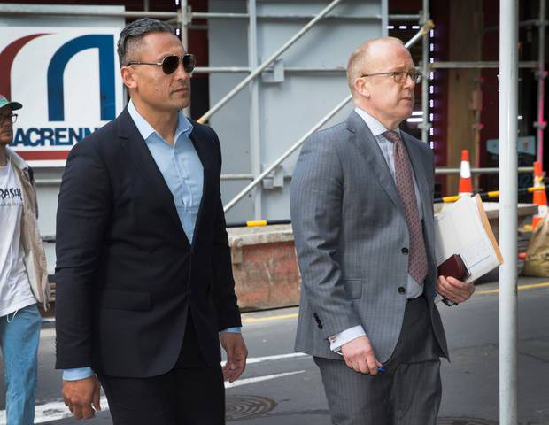 Actor Rene Naufahu walks to court in 2017 with his lawyer Ron Mansfield. Photo / Nick Reed