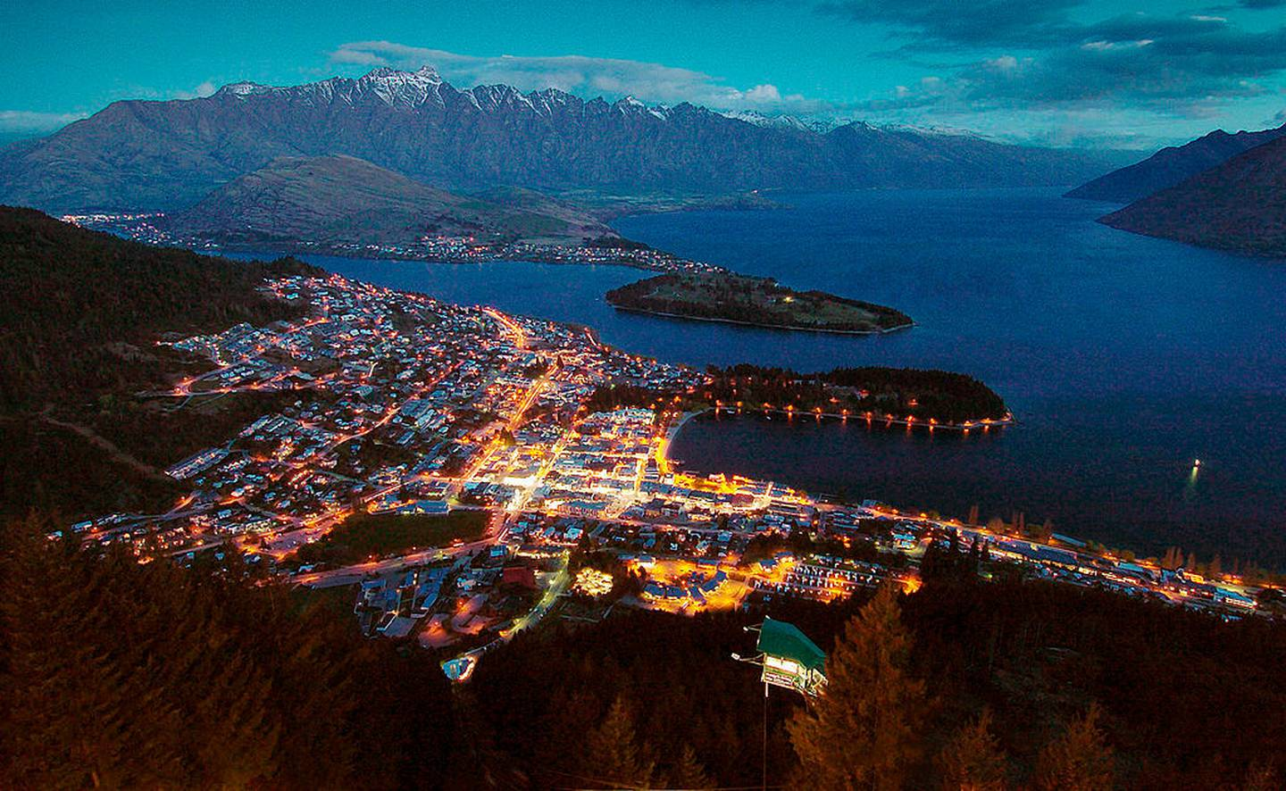 Queenstown at dusk with Lake Wakatipu and the Remarkables mountain range. Photo / Getty