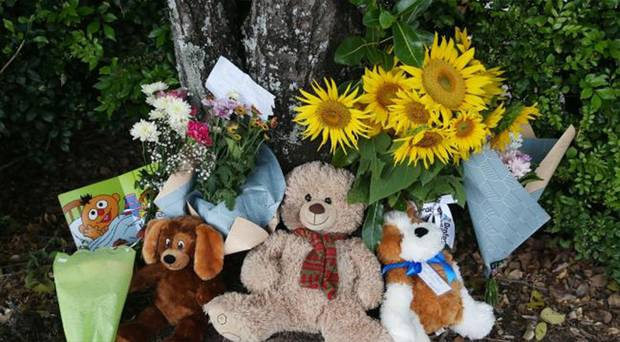 Members of the public left flowers and teddies at the Goodstart Early Learning Centre. Photo / News Corp Australia