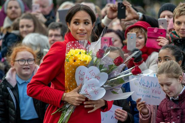 Britain's Meghan, Duchess of Sussex with Prince Harry greet the crowds of people during a visit to Birkenhead. Photo / AP