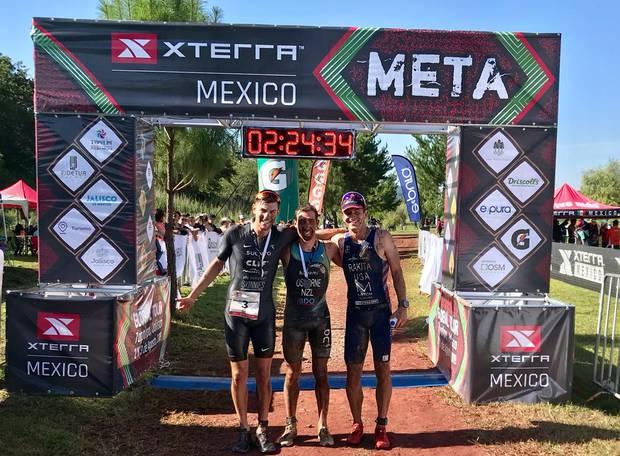 Xterra Mexico winner Sam Osborne (centre) with second placed Karsten Madsen (left) and third placed Branden Rakita. Photo / Supplied