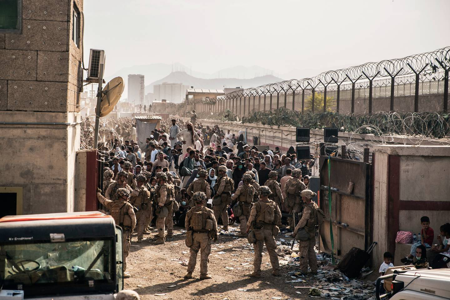 US soldiers try to control the crowds outside Kabul's airport. Photo / AP