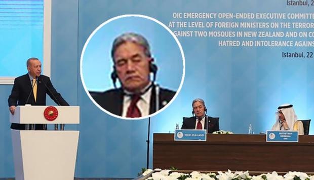President Recep Erdogan of Turkey delivers a speech at the Islamic Summit in Istanbul on Friday as Foreign Minister Winston Peters appears to be in deep contemplation. Photo / Supplied