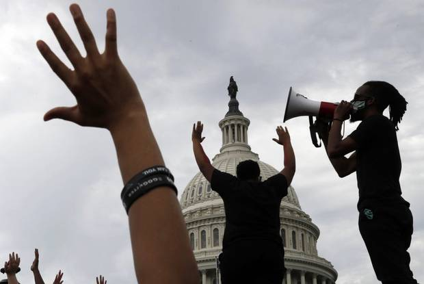 Demonstrators protest the death of George Floyd as they gather today on the East side of the U.S. Capitol in Washington. Photo / AP