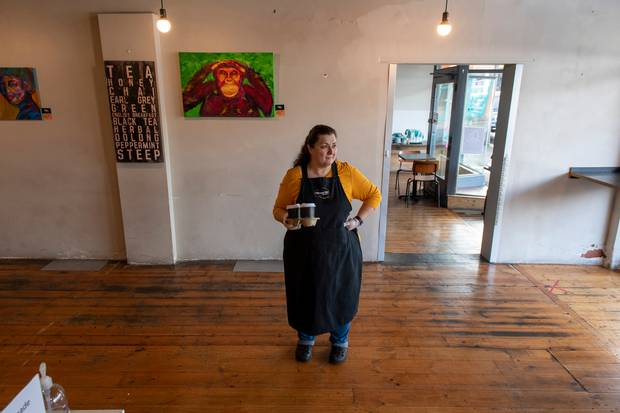 Cafe owner Maria Iatrou stands in her empty coffee shop in Melbourne.