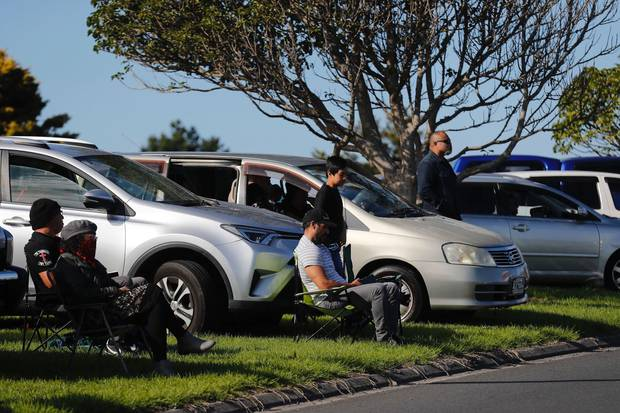 Churchgoers watch the Destiny Church service from the carparking lot. Photo / Dean Purcell