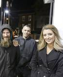Johnny Bobbitt Jr., left, Kate McClure, right, and McClure's boyfriend Mark D'Amico pose at a Citgo station in Philadelphia. Photo / AP