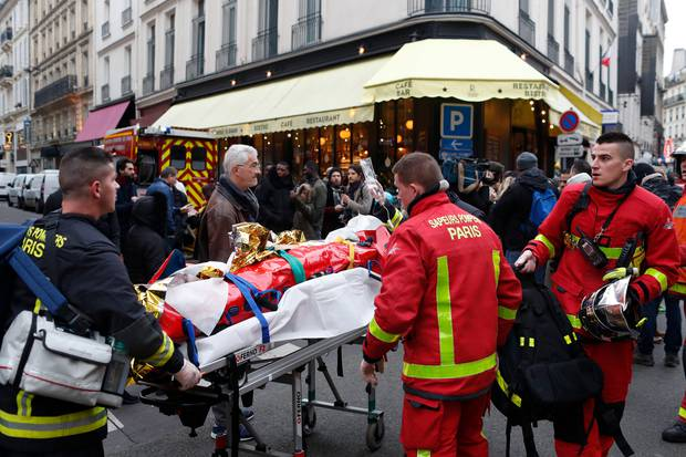 Firefighters evacuate a man from the scene of a gas leak explosion in Paris. Photo / AP
