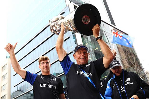Peter Burling and Grant Dalton celebrate with the Americas Cup. Photo / Getty