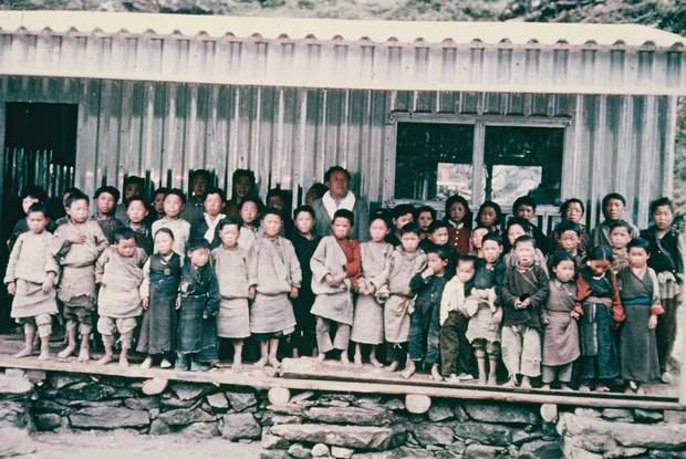 Khumjung School and its pupils in 1961 soon after the original aluminium classrooms were built by Sir Edmund Hillary, his expedition team and local people. Photo / Himalayan Trust