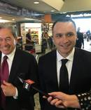 Peters was met at the airport by MP Darroch Ball and a waiting media pack. Photo / Nicholas Jones