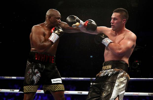 Dillian Whyte, left, and Joseph Parker battle during their heavyweight bout at the O2 Arena in London, Saturday, July 28, 2018. (Nick Potts/PA via AP)