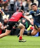 Malakai Fekitoa fends off George Bridge during the Highlanders' 22-25 loss to the Crusaders in Christchurch last month. Photo / Photosport.