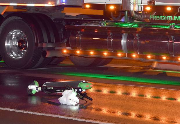 A Lime e-scooter lies on the road beside a truck after a crash in the early hours of this morning. Photo / Stephen Jaquiery