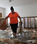 Regina Perry cleans out of her home that was inundated with water in Hurricane Harvey. Photo / Getty