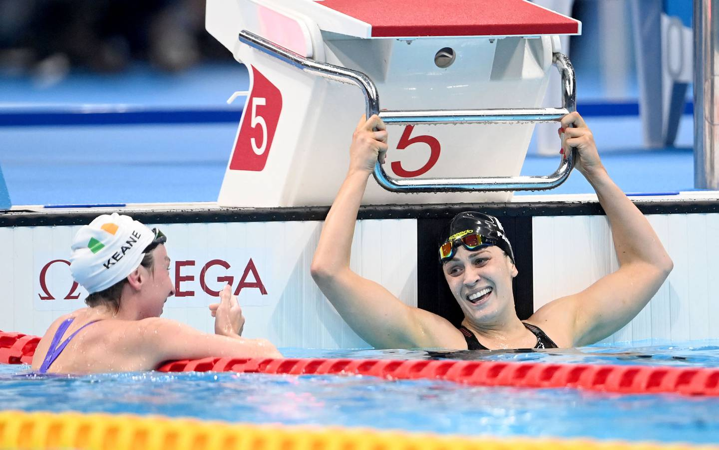 Ellen Keane and Sophie Pascoe celebrate after the women's SB8 100m breaststroke final. Photo / Photosport