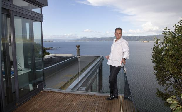 Matthew Ryan on the deck of his house in Karaka Bay, Wellington, which he rented to a foreign diplomat. Photo / Mark Mitchell