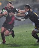 Israel Dagg of the Crusaders is tackled by Waisake Naholo of the Highlanders. Photo / Getty