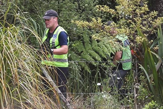 Police searching the bush off Scenic Drive in the Waitakere Ranges for Grace Millane's body. New Zealand Herald Photograph by Doug Sherring