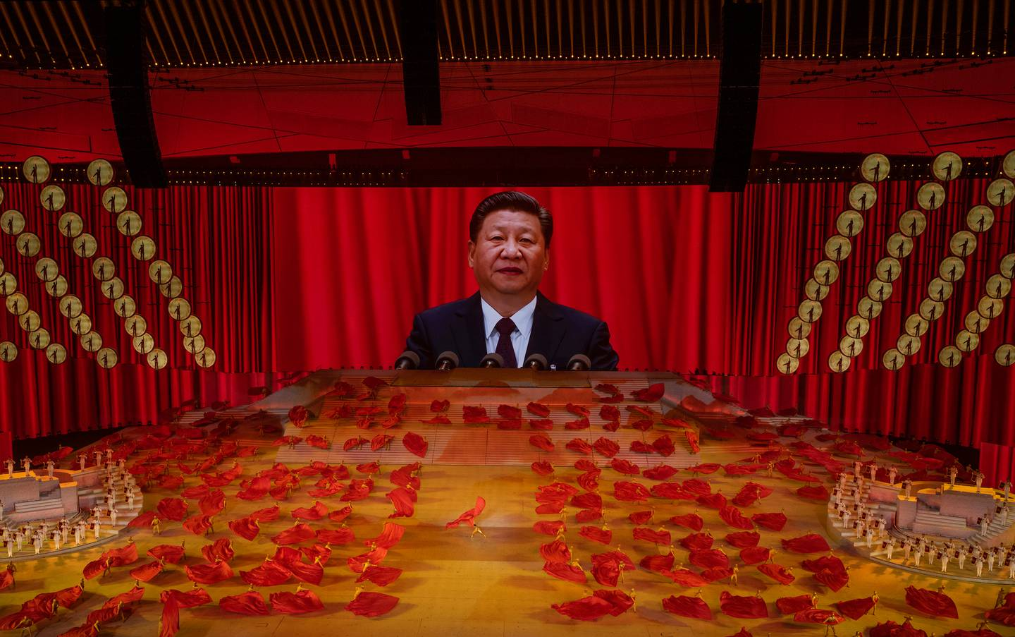 Chinese President and Chairman of the Communist Party Xi Jinping appears on a large screen as performers dance during a mass gala marking the 100th anniversary of the Communist Party. Photo / Getty Images
