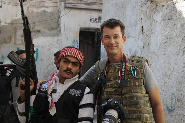 British photojournalist John Cantlie (right) poses with a Free Syrian Army rebel in Aleppo, Syria.