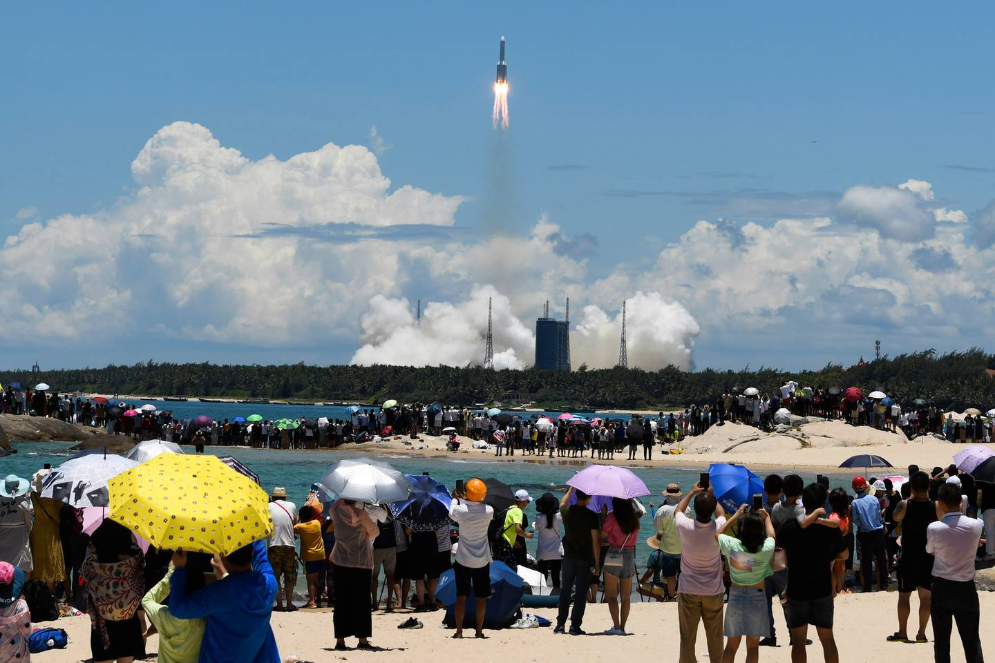 Spectators watch as a Long March-5 rocket carrying the Tianwen-1 Mars probe lifts off from the Wenchang Space Launch Center in southern China's Hainan Province. Photo /AP