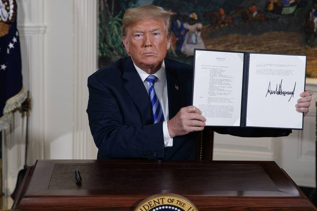 President Donald Trump shows a signed Presidential Memorandum after delivering a statement on the Iran nuclear deal. Photo / AP