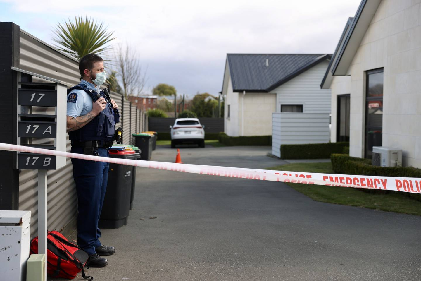 Police stand guard at the scene of the Timaru triple homicide. Photo / George Heard