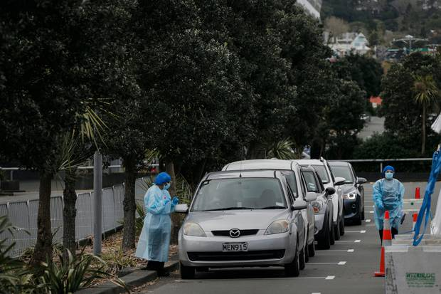 People in cars line up to be tested at the Mt Eden testing station. Photo / Alex Burton