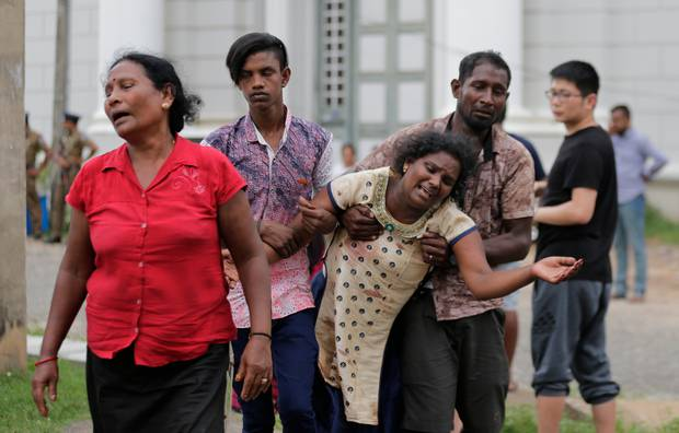 Relatives of a blast victim grieve outside a morgue in Colombo, Sri Lanka. Photo / AP