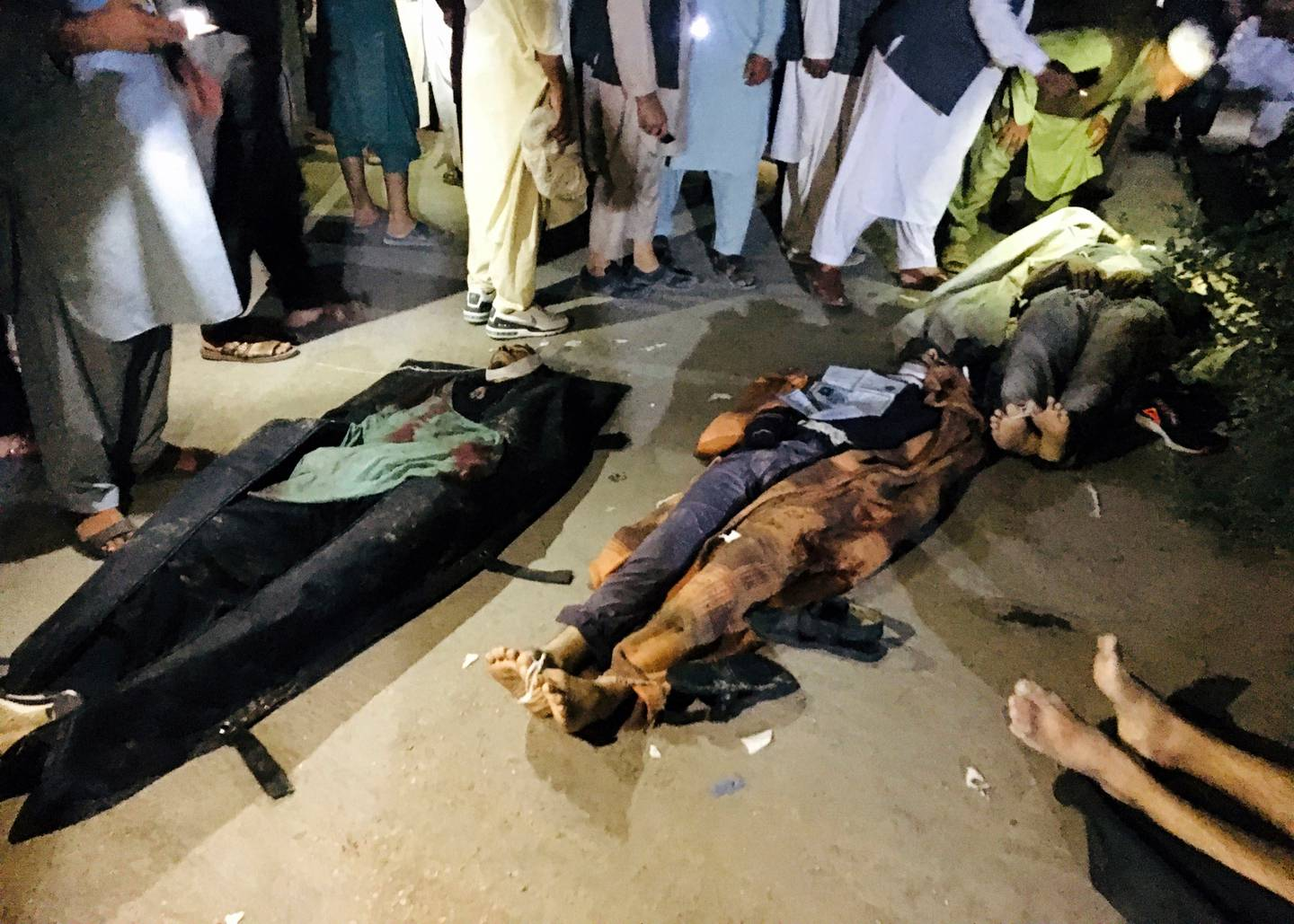 Dead bodies of Afghans lie on the ground at a hospital after deadly attacks outside the airport in Kabul, Afghanistan. Photo / AP