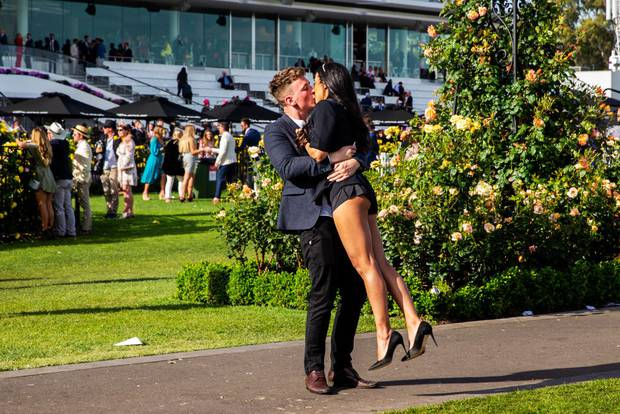 Two race-goers share a kiss after the 2019 Melbourne Cup Day. Photo / Getty Images