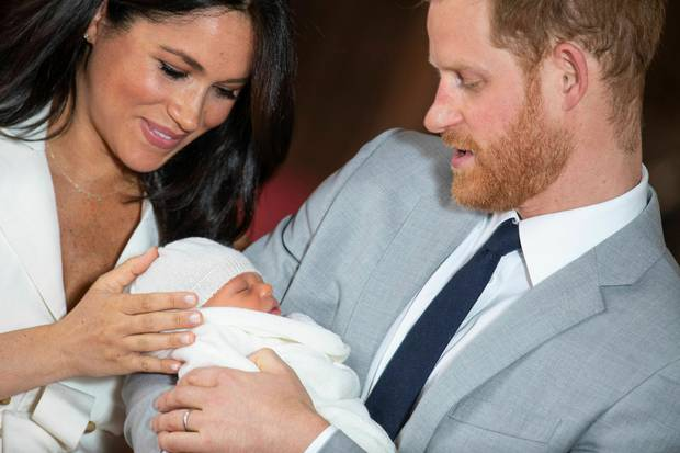 New-mum Meghan, Duchess of Sussex, was touching baby Archie's head and looking happy and emotional with Prince Harry as they presented their new baby to the world. Photo / AP