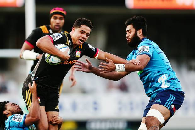 Anton Lienert-Brown of the Chiefs fends against Akira Ioane of the Blues. Photo / Photosport