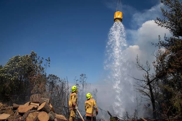 The NZ Defence Force fire fighters are contributing to improving and advancing the fire break system to help maintain control of the fire. Photo / Chad Sharman
