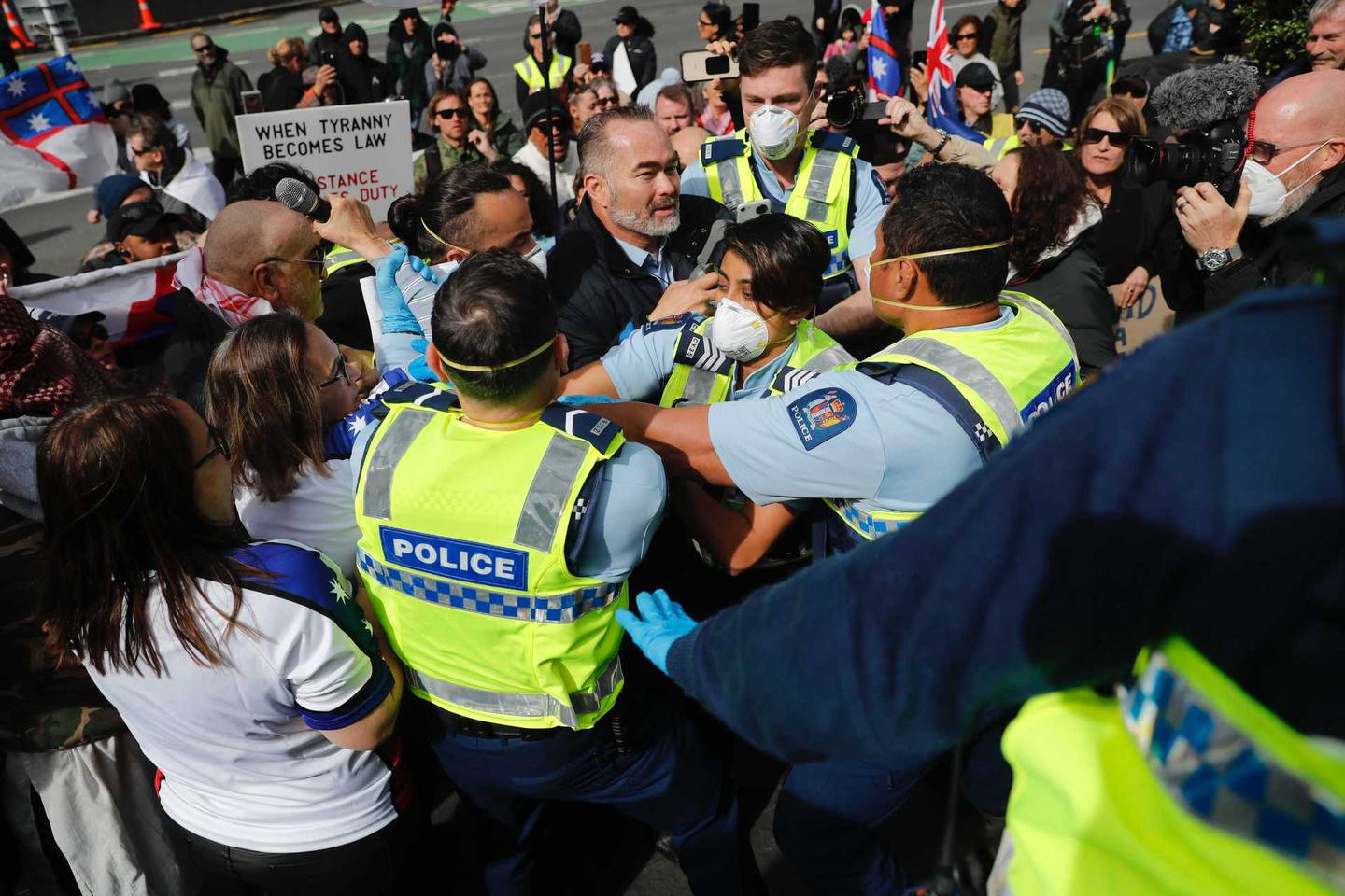 Police officers move in to arrest Billy Te Kahika at today's protest in the Auckland CBD. Photo / Dean Purcell