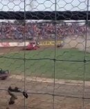 The footage shows a green stock car leaving the track and crashing into photographer John Sprague.
