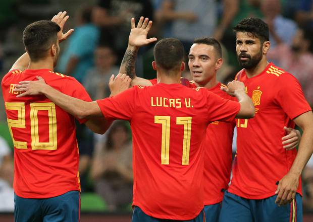 Spanish players celebrate a goal during a friendly match between against Tunisia. Photo / AP