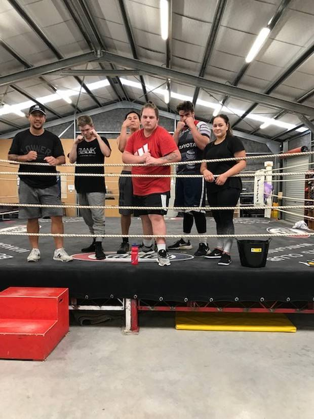 At the boxing gym are (from left) specialist case worker Jacob Makara-Moreland, Darcey Chambers, Wiremu Tamehana, Braxton Nikora-Whale, specialist case worker Jesse Hamilton-Hall and Tala Thompson.