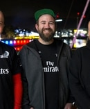 Southern Spars boat builders Paul Morris, Brendan Jones and Robert Howatson stand in Auckland's Viaduct after the win of the Americas cup by Emirates Team New Zealand. Photo / Nick Reed