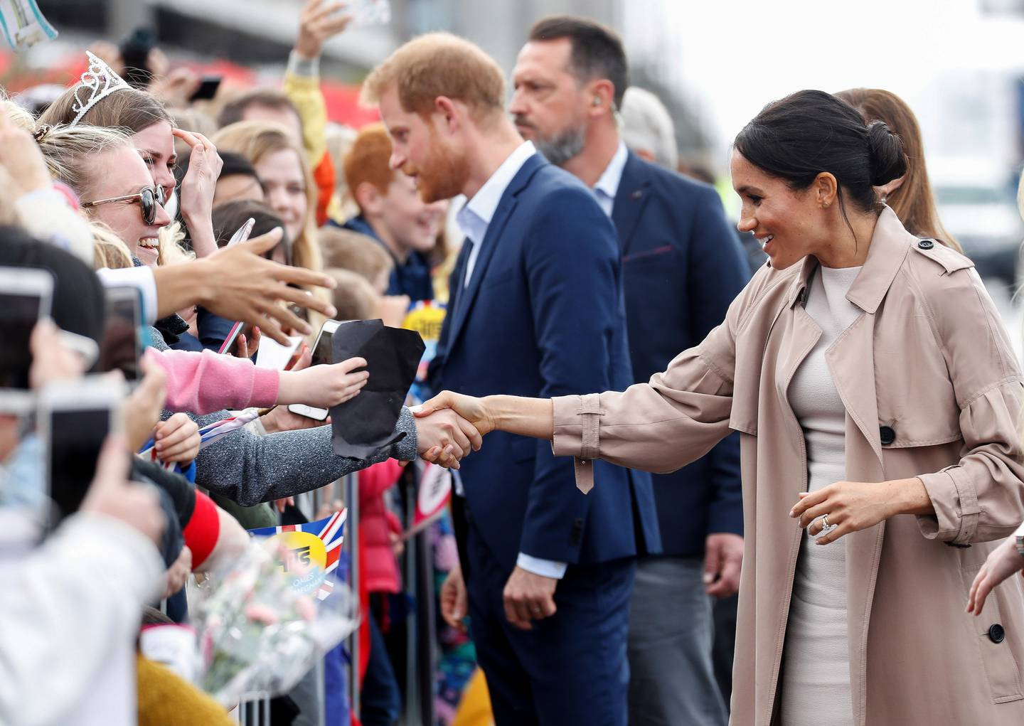 Prince Harry and Meghan, Duchess of Sussex meet members of the public during a walkabout at the Viaduct in Auckland. Photo / AP