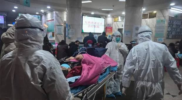 Medical staff wearing protective clothing arrive with a patient at the Wuhan Red Cross Hospital in Wuhan on January 25. Photo / Getty