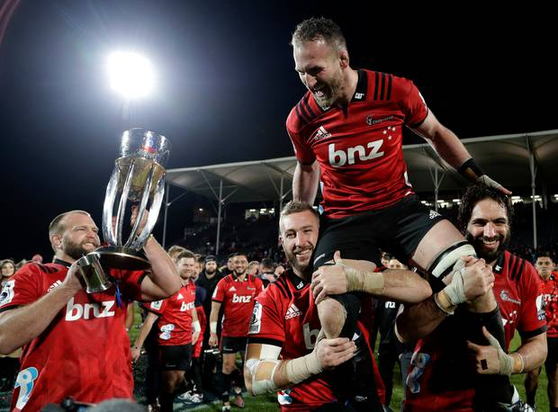 Crusaders Kieran Read is held aloft by teammates as he celebrates after they defeated the Jaguares 19-3 to win the Super Rugby final in Christchurch. Photo / AP
