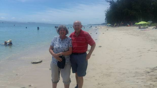 Rod Pascoe, 67 with his wife Julie Brockway on a beach on Reunion Island after they managed to avoid the protests. Photo / Supplied
