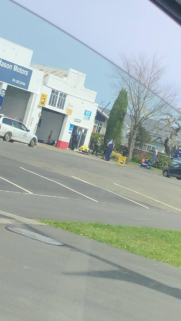 A witness said she saw police cuffing a man around the corner of the Lee Mason Motors building before speaking with him and letting him go. Photo / Supplied