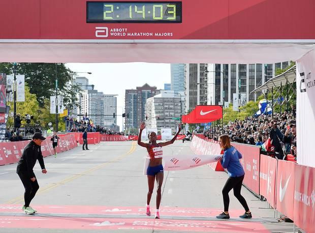 Brigid Kosgei breaking the world record in Chicago. Photo / Getty Images