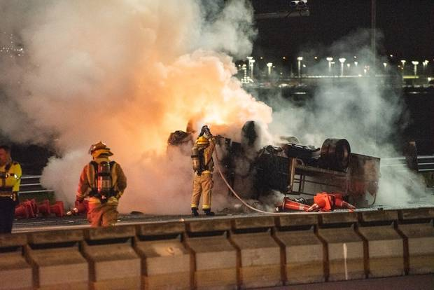 Fire fighters were on the scene to extinguish the blaze following the crash in the early hours of this morning. Photo / Antony Gray