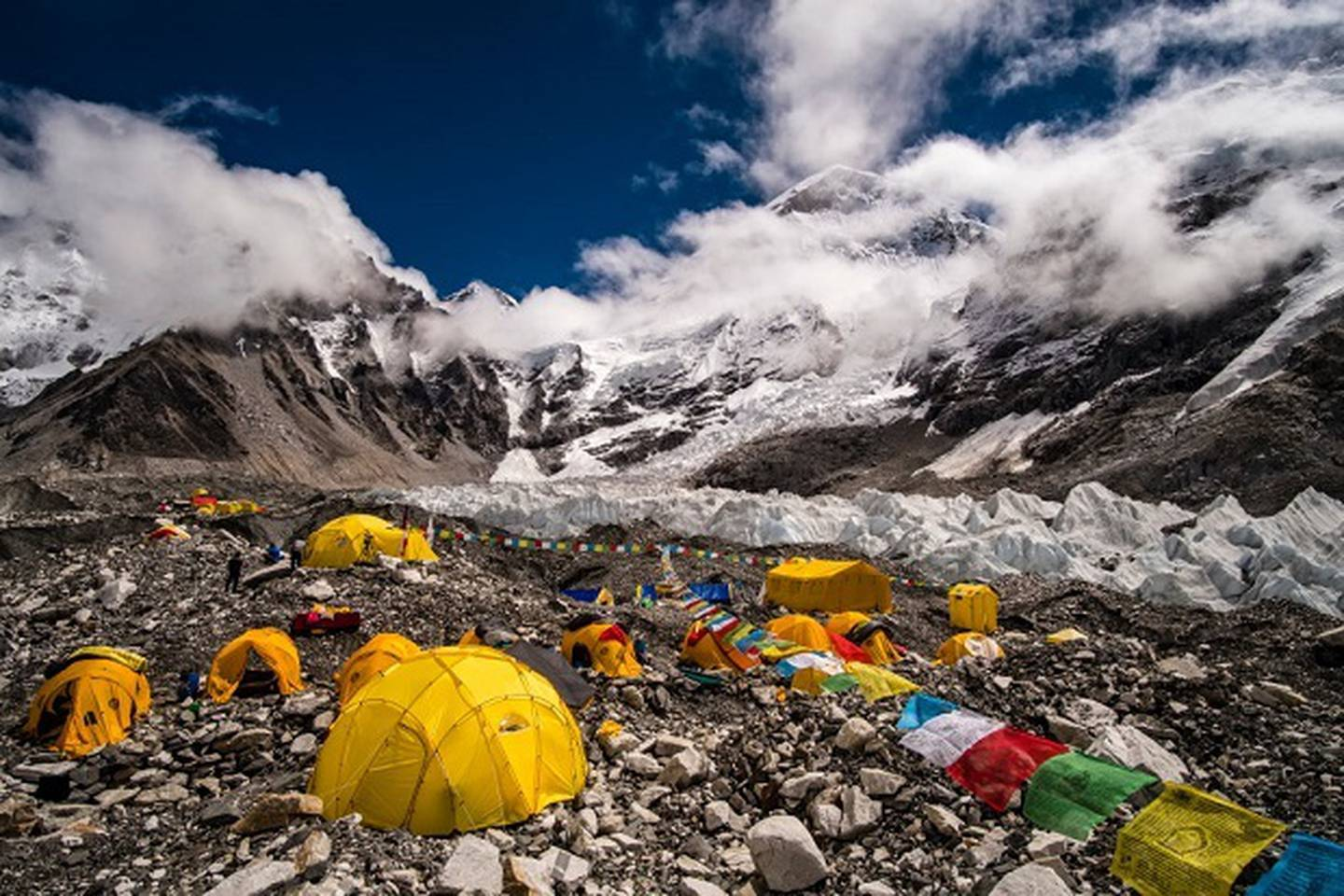 Tents set up at Everest Base Camp on Khumbu glacier, Mt Everest behind covered by monsoon clouds. Photo / Getty Images