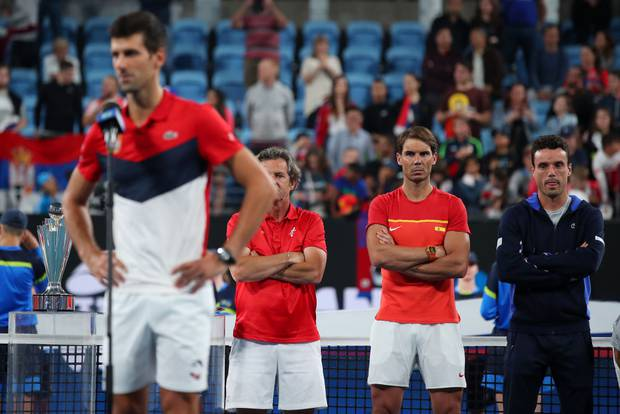 Rafael Nadal watches on as Novak Djokovic delivers a victory speech after Serbia defeated Spain in the ATP Cup Final. Photo / Getty Images